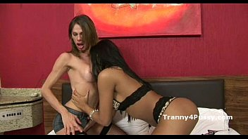Girl sucks shemale Sexy brunette messes around with skinny tranny in fishnets then sucks her cock