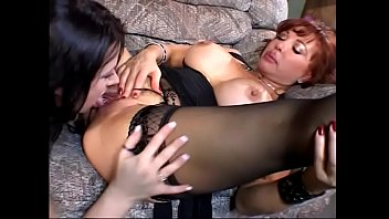 Redheaded babe Sexy Vanessa eats out the black haired babe