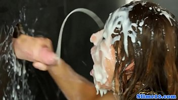 Drenched in cum Gloryhole sucking babe gets drenched in cum