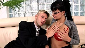Horny secretary fucked on a couch in lingerie porn image