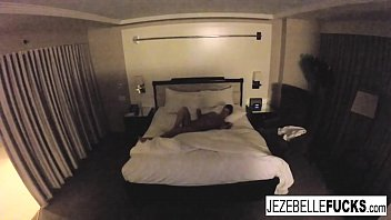 Sexy Jezebelle Bond hangs out in her hotel room