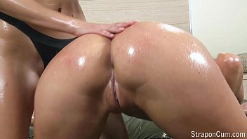 StraponCum: Oiled Strapon Play.