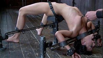 Slut in back arch bondage whipped
