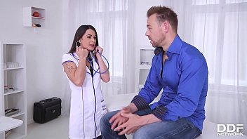 Sexy doctor Giorgia Roma loves to footjob and fuck her patients