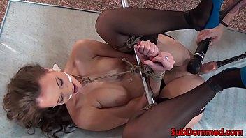 Nipple clamped sub spreadeagled for toying صورة