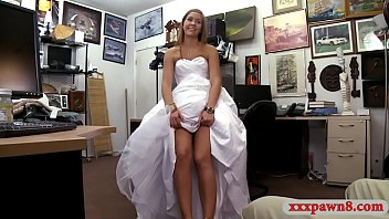 Woman in wed dr ess boned at the pawnshop e pawnshop