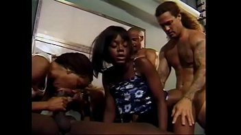 Three busty black female employees suck cocks and gets their pussies fuckd on the table