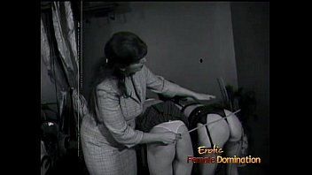 Two foxy lassies get spanked and whipped by a lusty redhead