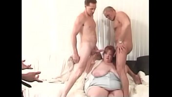 Big tits red head chick Rosa Linda gets tits licked and twat fucked by hot cock duo on sofa
