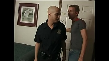 Guy gives police officer head and bangs on sofa