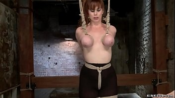 Gagged busty lesbian slave is toyed