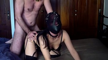 Fucking my hooded hot wife in stockings, wearing a gas mask