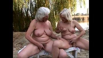 Long haired blond slut fingers grandma on the bench