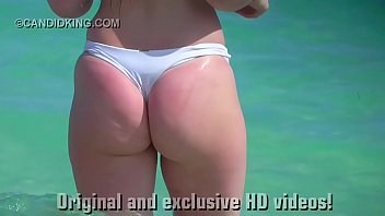 Must see teen PAWG in a thong bikini on the beach in public! preview image