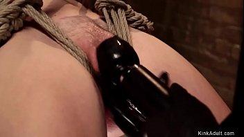 Blonde slave in back arch suspension