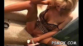 This doxy shows her huge bust while holding a cigarette