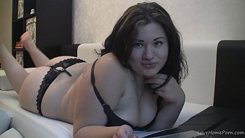 Chubby brunette Kira fingering her pussy