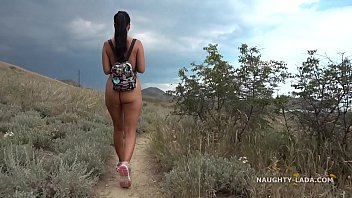 Girls walking up beach naked - The naked hike