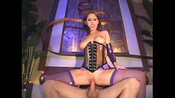 Crossdresser lingerie Brunette fucks in a shiny latex corset and fishnets