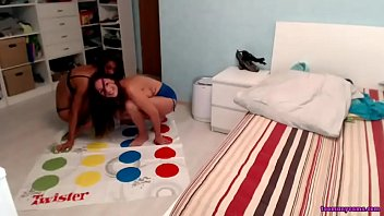 Twins sisters are playing twister in front of cam
