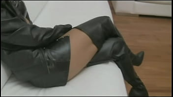 Daniela posing in kneehigh leather boots, leather jacket and leather skirt