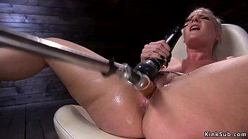 Wet pussy blonde fucks machine in chair