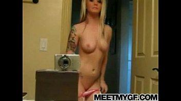 Emo girl gives strip tease