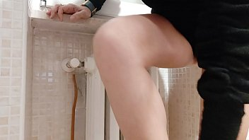 exhibitionist wife hides in the bathroom and films herself while playing in stockings preview image