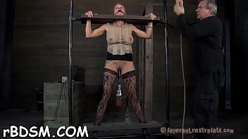 Gagged hottie gets her racks bounded and clamped