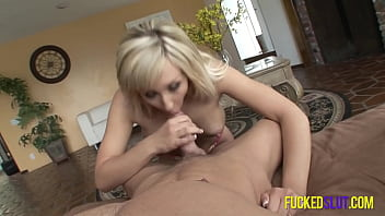 Blonde housewife is on her knees blowing her man