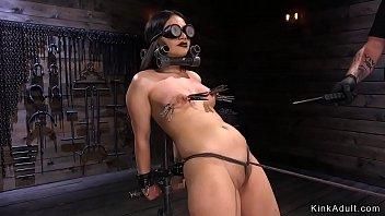 Brunette wet pussy toyed in bondage image