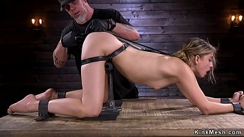 Blonde strapped in metal device bondage