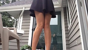 Womens piss stories - Upskirt milf pees standing on porch