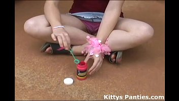 Teen skirt tube - Kitty blowing bubbles in her miniskirt