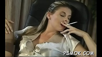 Inviting breasty babe reading and smoking with her ally