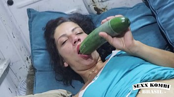 Addict comforts herself with giant cucumber in van. View More in XV RED
