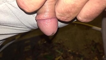 Tiny dick pissing outside