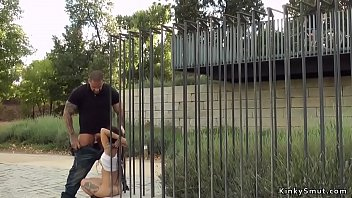 Petite slave is fucked in public park