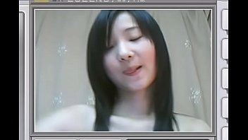 Cute Asian teen shows her flat chest and rubs herself