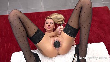 Horny babe in stockings orgasms with a magic wand