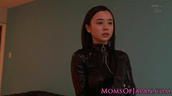 Costumed asian mom in catsuit facialized