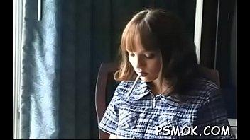 Mature slut blows a dude while smoking a cigarette