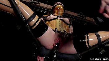 Rubber slave bondage - Sub in plastic corset in device bondage