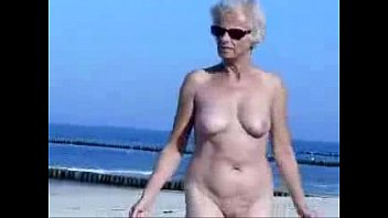 Mature granny naked Must see this cute granny totally naked at beach