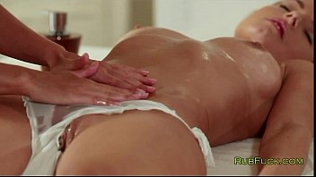 Busty brunette and her masseur fingering