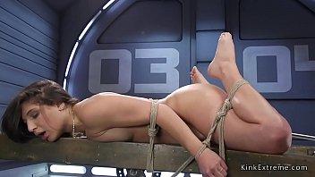 Brunette in rope bondage anal fucked