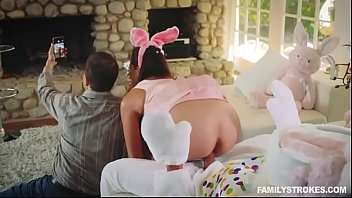 Sneaky sex with a sexy teen getting fucked by her uncle dressed up as an Easter bunny behind her par