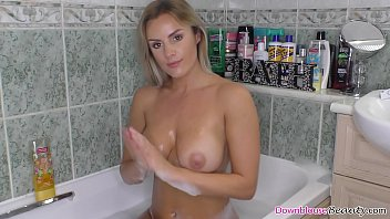 Boob washing Big tits babe washing her natural boobs in the bathtub