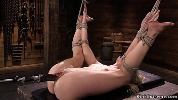Bondage hands above head Small tits babe in bondage fucks machine