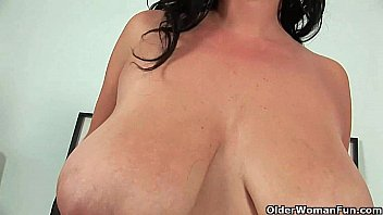 Image: Soccer mom with big boobs fucks herself with two dildos